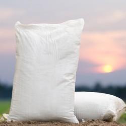 Fertilizer bag over sunrise
